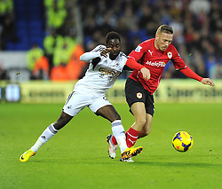 Swansea City's Nathan Dyer battles for the ball with Cardiff City's Craig Bellamy - Photo mandatory by-line: Joe Meredith/JMP - Tel: Mobile: 07966 386802 03/11/2013 - SPORT - FOOTBALL - The Cardiff City Stadium - Cardiff - Cardiff City v Swansea City - Barclays Premier League