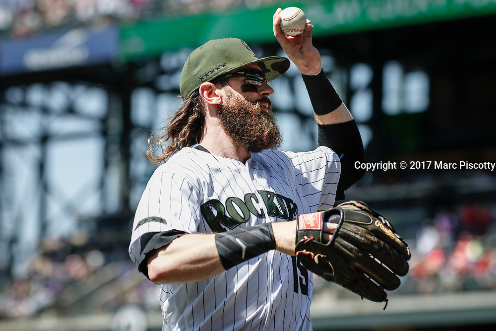 SHOT 5/28/17 1:52:59 PM - Colorado Rockies outfielder Charlie Blackmon #19 tosses a ball to fans on his way to the dugout during a regular season MLB game against the St. Louis Cardinals at Coors Field in Denver, Co. The Rockies won the game 8-4. (Photo by Marc Piscotty / © 2017)