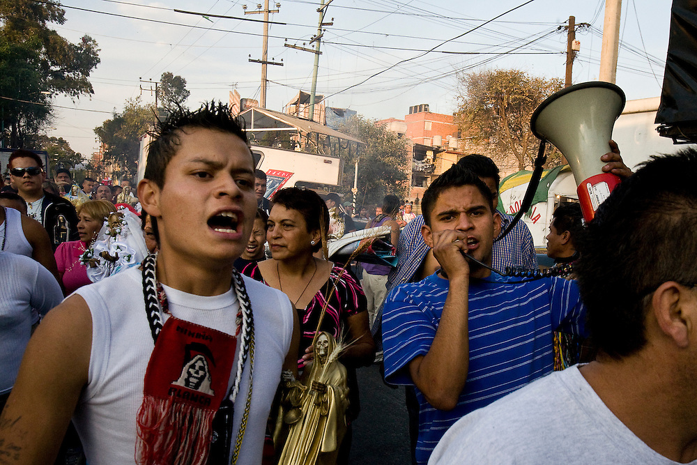 Hundreds of Sante Muerte devotees arrive at the shrine in Tipito after marching across Mexico City.