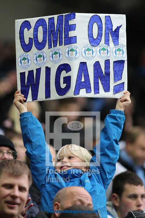 Picture by MIchael Sedgwick/Focus Images Ltd. 07900 363072.11/04/12.Come on Wigan! A young Wigan Athletic fan in the crowd before the game against Manchester United in the Barclays Premier League match at the DW Stadium, Wigan.