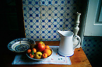 January 1998, Northern Portugal --- Fruit Still Life and Tiled Walls in Rustic Country Home --- Image by © Owen Franken/CORBIS