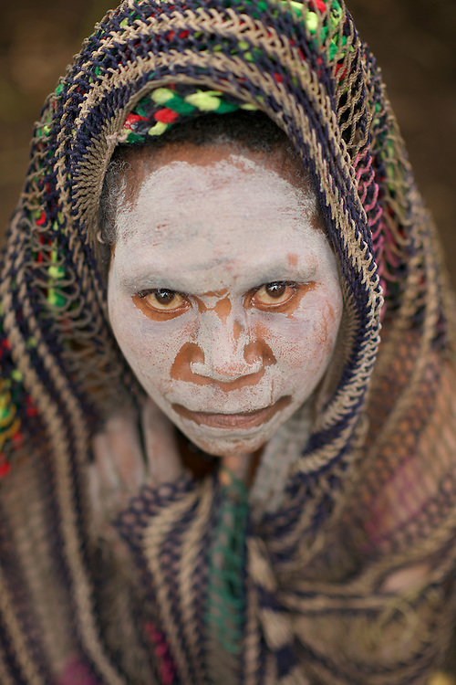 Young woman in mourning at Tombete Village in the Southern Highlands of Papua New Guinea, where villagers demonstrate traditional crafts and hunting.