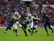 Buffalo Bills LeSean McCoy getting tackled by Jacksonville Jaguars Josh Evans during the Buffalo Bills v Jacksonville Jaguars NFL International Series match at Wembley Stadium, London, England on 25 October 2015. Photo by Matthew Redman.