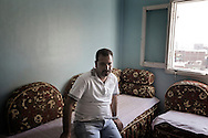 Egypt, Cairo: Magdy Wany poses for a portrait inside his sister's house. Magdy collects Cairo's trash and recycle it inside Moqattam, the christian coptic quarter in Cairo where live 40.000 Zabbaleen (garbage collectors). ph.Christian Minelli...