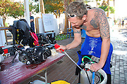 Scuba diver cares for his underwater photographic equipment
