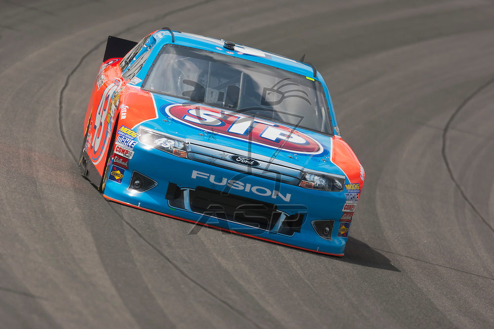 KANSAS CITY, KS - APR 20, 2012:  Aric Almirola (43) brings his car through the turns during a practice session for the STP 400 at the Kansas Speedway in Kansas City, KS.
