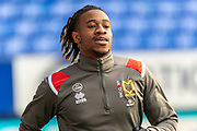 David Kasumu of MK Dons warming up before the EFL Sky Bet League 1 match between Bolton Wanderers and Milton Keynes Dons at the University of  Bolton Stadium, Bolton, England on 16 November 2019.