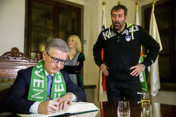 Franjo Bobinac, president of RZS signing the City of Ljubljana's Golden Book next to Veselin Vujovic, head coach during reception of Slovenian National Handball Men team after they placed third at IHF World Handball Championship France 2017, on January 30, 2017 in City hall, Ljubljana centre, Slovenia. Photo by Vid Ponikvar / Sportida
