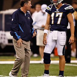 August 27, 2010; New Orleans, LA, USA; San Diego Chargers head coach Norv Turner talks to quarterback Philip Rivers (17) on the field prior to the start of a preseason game at the Louisiana Superdome. The New Orleans Saints defeated the San Diego Chargers 36-21. Mandatory Credit: Derick E. Hingle
