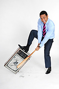 CNN news anchor Don Lemon crushes a television during a Creative Loafing cover shoot.