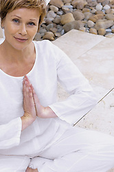 Jul. 26, 2012 - Woman meditating (Credit Image: © Image Source/ZUMAPRESS.com)