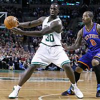 04 March 2012: Boston Celtics power forward Brandon Bass (30) passes the ball as New York Knicks shooting guard J.R. Smith (8) defends on him during the Boston Celtics 115-111 (OT) victory over the New York Knicks at the TD Garden, Boston, Massachusetts, USA.