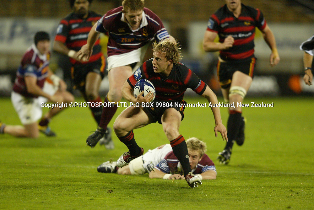 Canterburys Ben Hurst breaks a tackle which leads to some evasive action. NPC Rugby Canterbury Vs Southland, Jade Stadium, Christchurch 18.09.04. Canterbury won 52-13.<br />PHOTO: PHOTOSPORT