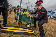 A childs buggy is given a ticket in the circus field - The 2017 Glastonbury Festival, Worthy Farm. Glastonbury, 24 June 2017