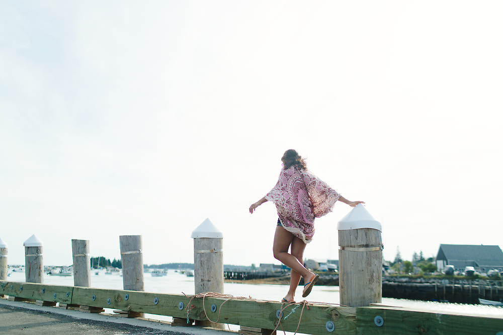 Young Woman Balancing on Pier, Vinalhaven, Maine.