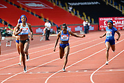 Shaunae Miller-Uibo (BAH), left, beats Dina Asher-Smith (GBR) right, to win the 200m wines race in a time of 22.24 during the Birmingham Grand Prix, Sunday, Aug 18, 2019, in Birmingham, United Kingdom. (Steve Flynn/Image of Sport via AP)