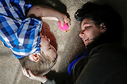 Julia Fresso plays with her son Mason, 4, at the family's home in Lake in the Hills, Ill. Mason was diagnosed with autism at 1 and the family is trying to raise money for an autism assistance dog.