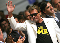 File photo : Johnny Hallyday leaves the closing of UMP Summer University in Marseille, France, on September 03, 2006. France's biggest rock star Johnny Hallyday has died from lung cancer, his wife says. He was 74. The singer - real name Jean-Philippe Smet - sold about 100 million records and starred in a number of films. Photo by Orban-Taamallah/ABACAPRESS.COM