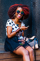 Trendy young woman in the hip urban neighborhood of Maboneng Precinct, Johannesburg, South Africa.