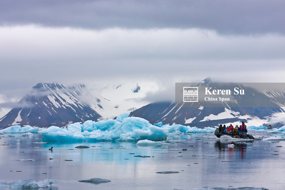 Tourists on zodiac with iceberg, Hornsund, Spitsbergen's southernmost fjord, Norway