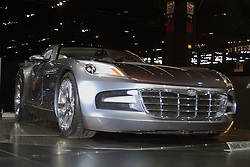 09 February 2005:  Chrysler Group's superstar for the '05 Chicago show was the Firepower concept, which combined taut coupe styling with a Viper-like chassis design and new 425 horsepower, 6.1-liter Hemi V-8. The result was a rear-wheel drive, grand tourer that had an estimated 0-60 mph time of less than 4.5 seconds and top speed of 175 mph. Other components included special suspension, four-wheel disc brakes, five-speed AutoStick transmission, plus 19-inch front and 20-inch rear wheels. Inside the Ocean Deep Blue two-passenger cockpit was Oyster leather and Behr maple accent, which beautifully balanced the Hydro Silver Pearl exterior.<br /> <br /> <br /> First staged in 1901, the Chicago Auto Show is the largest auto show in North America and has been held more times than any other auto exposition on the continent.  It has been  presented by the Chicago Automobile Trade Association (CATA) since 1935.  It is held at McCormick Place, Chicago Illinois