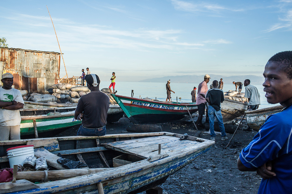 Fishermen get set to head out from the Carrefour area early in the morning on Monday, December 15, 2014 in Port-au-Prince, Haiti.