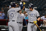 PHOENIX, AZ - JUNE 08:  Corey Dickerson #10 of the Tampa Bay Rays is congratulated by teammate Evan Longoria #3 after hitting a solo home run against the Arizona Diamondbacks in first inning at Chase Field on June 8, 2016 in Phoenix, Arizona.  (Photo by Jennifer Stewart/Getty Images)