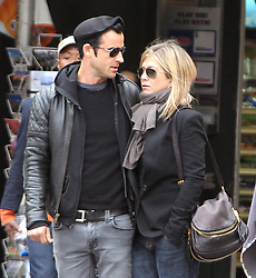 "File photo - Actress Jennifer Aniston with her boyfriend Justin Theroux walk in The West Village surrounded by paparazzi on their way back to her apartment in New York City, NY, USA on September 16, 2011. Hollywood couple Jennifer Aniston and Justin Theroux are separating after two years of marriage. The pair, who reportedly met on the set of comedy film Wanderlust, said the mutual decision was ""lovingly made"" at the end of last year. Photo by Charles Guerin/ABACAPRESS.COM"