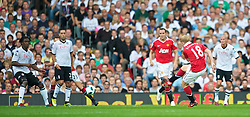 LONDON, ENGLAND - Sunday, August 22, 2010: Manchester United's Paul Scholes scores the opening goal against Fulham, his 150th goal for the club, during the Premiership match at Craven Cottage. (Pic by: David Rawcliffe/Propaganda)