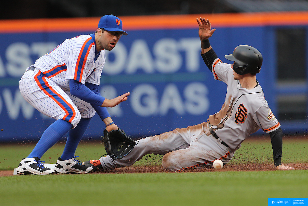 NEW YORK, NEW YORK - MAY 01: Matt Duffy #5 of the San Francisco Giants steals second as second baseman Neil Walker #20 of the New York Mets fields the throw during the New York Mets Vs San Francisco Giants MLB regular season game at Citi Field on May 01, 2016 in New York City. (Photo by Tim Clayton/Corbis via Getty Images)