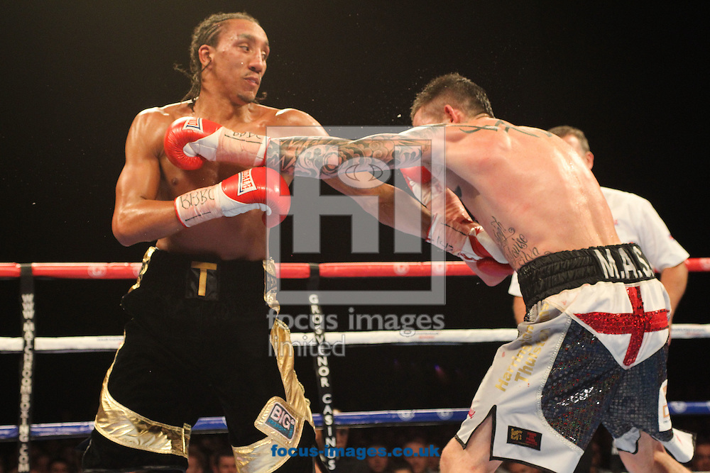 Tyrone Nurse  (Black /Gold Shorts) and Dave Ryan  (White/Silver Shorts) during their Vacant Commonwealth Light Welterweight title bout at the First Direct Arena, Leeds<br /> Picture by Stephen Gaunt/Focus Images Ltd +447904 833202<br /> 04/10/2014