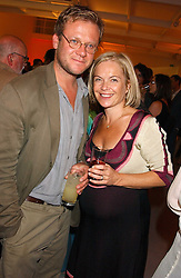TV presenter MARIELLA FROSTRUP and her husband JASON McCUE  at a party to celebrate the publication of 'Shalimar The Clown' by Salman Rushdie, held at the David Gill Galleries, 3 Loughborough Street, London SE11 on 7th September 2005.<br />