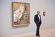 UNITED KINGDOM, London: 26 February 2018 <br /> David Dawson, who modelled for the painting behind him 'David and Eli' 2003-4 (right) poses for a picture at The Tate Britain this morning. The painting forms part of Tate Britain's landmark exhibition entitled 'All Too Human: Bacon, Freud and a Century of Painting Life' which celebrates the intense experience of life captured with paint. <br /> The exhibition runs from 28 February - 27 August 2018.<br /> Photograph: Rick Findler