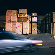 Shipping crates are stacked on the West side of the Salt Palace after the conclusion of the Outdoor Retailer summer trade show.