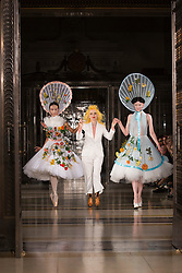 © Licensed to London News Pictures. 16/09/2013. London, England. Fashion Designer Pam Hogg with models during the finale of her show. Pam Hogg off-schedule catwalk show during London Fashion Week at Fashion Scout/Freemason's Hall. Photo credit: Bettina Strenske/LNP