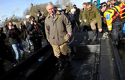 © Licensed to London News Pictures.04/02/2014. Muchelney, Somerset. Prince Charles visits the floods on the Somerset levels today visiting the people of Muchelney that have been cut off by the flood waters . Photo credit : MarkHemsworth/LNP