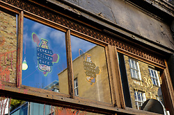© Licensed to London News Pictures. 27/09/2015. City, UK. The Cereal Killer cafe in Brick Lane the day after a paint attack during the previous night by activists protesting against gentrification in London's East End. Photo credit : Stephen Chung/LNP
