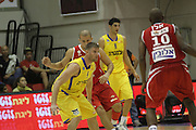 Maccabi Tel Aviv Basketball team (Yellow) Playing Hapoel Gilboa-Galil (Red) on October 16th 2011. Final result Maccabi 95 Hapoel 60