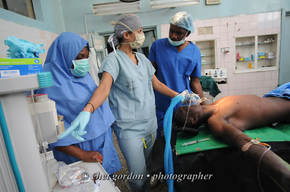 KANO, NIGERIA.  An American anesthesiologist (center) instructs two Nigerian OR nurses as she prepares a Nigerian patient for surgery at the Murtala Muhammad Specialist Hospital in Kano, Nigeria on Tuesday, December 4, 2012.