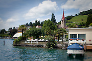 The waterfront and church of Weggis, a small town on Lake Lucerne, Switzerland.