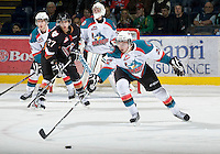 KELOWNA, CANADA, JANUARY 1: Mackenzie Johnston #22 of the Kelowna Rockets reaches for the puck as the Calgary Hitmen visit the Kelowna Rockets on January 1, 2012 at Prospera Place in Kelowna, British Columbia, Canada (Photo by Marissa Baecker/Getty Images) *** Local Caption ***