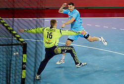Dragan Gajic of Slovenia vs goalkeeper of Poland Piotr Wyszomirski during handball match between National teams of Slovenia and Poland of Qualifications for EURO 2012, on March 9, 2011 in Arena Stozice, Ljubljana, Slovenia. Slovenia defeated Poland 30-28. (Photo By Vid Ponikvar / Sportida.com)