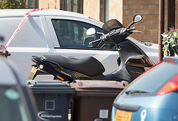 © Licensed to London News Pictures. 14/09/2016. London, UK. A moped is parked near the murder scene. A man named locally as Ricky Hayden, has been murdered as he and his father attempted to stop a gang stealing a moped from their drive in Gibbfield Close. Two men are in police custody. Photo credit: Peter Macdiarmid/LNP