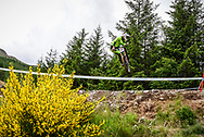 Matthew Walker goes sideways over the table tops during his practise run at the UCI Mountain Bike World Cup in Fort William.