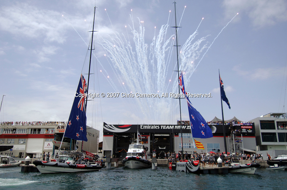 Fireworks go off behind the base as Emirates Team New Zealand leave the dock for the first race of the 32nd America`s Cup in Valencia, Spain on Saturday 23 June 2007. Alinghi won the match by 33 seconds. Photo : Chris Cameron/PHOTOSPORT