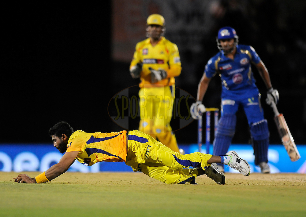 Ravindra Jadeja of The Chennai Superkings stops a ball of his own bowling during the eliminator match of the Pepsi Indian Premier League Season 2014 between the Chennai Superkings and the Mumbai Indians held at the Brabourne Stadium, Mumbai, India on the 28th May  2014<br /> <br /> Photo by Pal PIllai / IPL / SPORTZPICS<br /> <br /> <br /> <br /> Image use subject to terms and conditions which can be found here:  http://sportzpics.photoshelter.com/gallery/Pepsi-IPL-Image-terms-and-conditions/G00004VW1IVJ.gB0/C0000TScjhBM6ikg