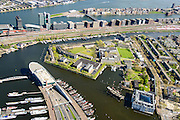 Nederland, Noord-Holland, Amsterdam, 09-04-2014;<br /> Marineterrein en Scheepvaartmuseum, beneden ingang IJtunnel met museum Nemo, boven Dijksgracht met spoorbaan, Piet Heinkade en IJ. Java-eiland en Amsterdam-Noord.<br /> <br /> QQQ<br /> luchtfoto (toeslag op standard tarieven);<br /> aerial photo (additional fee required);<br /> copyright foto/photo Siebe Swart