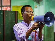 08 NOVEMBER 2015 - YANGON, MYANMAR: An elections worker announces that the polls at his polling place in central Yangon were closed after the election Sunday. The citizens of Myanmar went to the polls Sunday to vote in the most democratic elections since 1990. The National League for Democracy, (NLD) the party of Aung San Suu Kyi is widely expected to get the most votes in the election, but it is not certain if they will get enough votes to secure an outright victory. The polls opened at 6AM. In Yangon, some voters started lining up at 4AM and lines were reported to long in many polling stations in Myanmar's largest city.    PHOTO BY JACK KURTZ