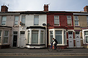 A young man cycles past a row of terraced houses in Bloomfield ward, Blackpool, Lancashire, England, United Kingdom. Bloomfield ward is the poorest council ward in Blackpool and one of the poorest in England and in 2012 had the lowest life expectancy for men in England. (photo by Andrew Aitchison / In pictures via Getty Images)