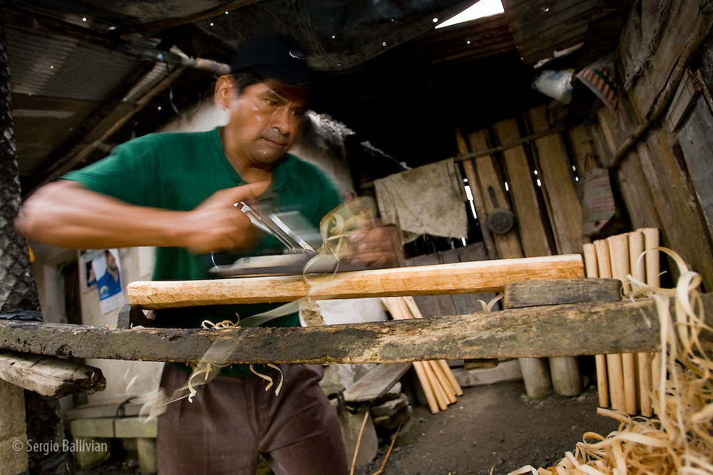 Artisan woodcarvers making axe handles by hand in the tropical jungle region of the Yungas region near the town of Coroico, three hours from La Paz, Bolivia.